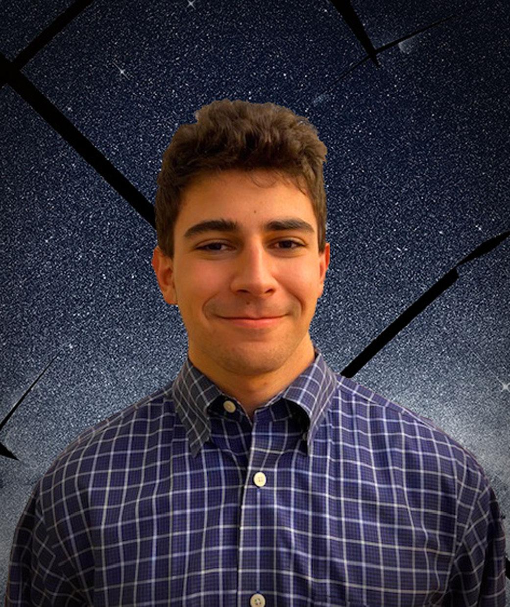 Intern Adam Freidman standing in front of a TESS image